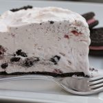 strawberry icebox pie on white plate