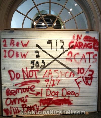 Hurricane Katrina exhibit - garage door - Presbytere museum