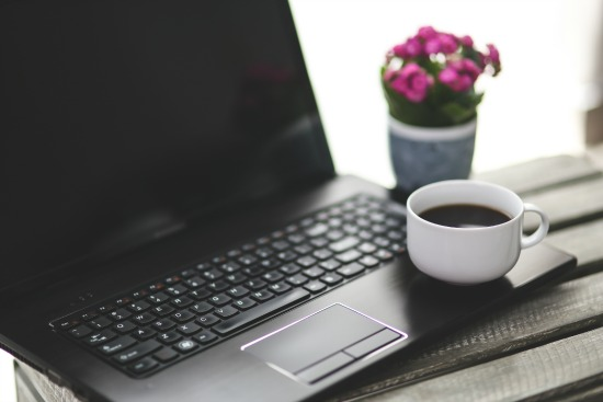 coffee cup by computer - coffee break