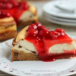 Cherry Topped Cheesecake with Triple Chocolate Chunk Cookie Crust