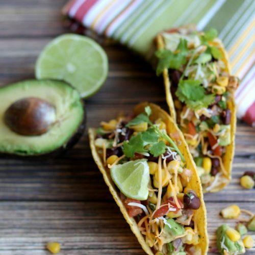chicken avocado tacos on wooden board