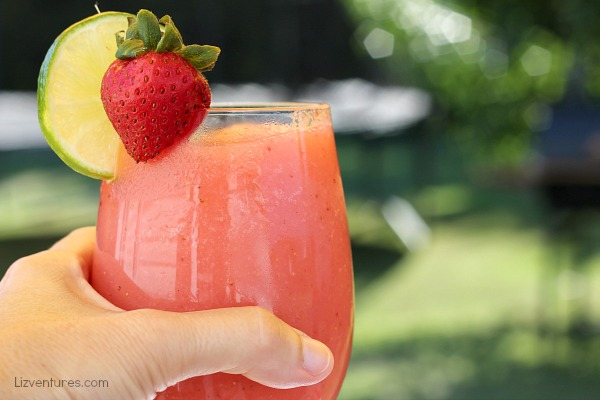 hand holding strawberry white wine slush_recipe