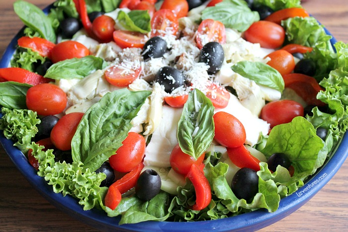 Fresh Italian salad recipe with basil oil vinaigrette dressing