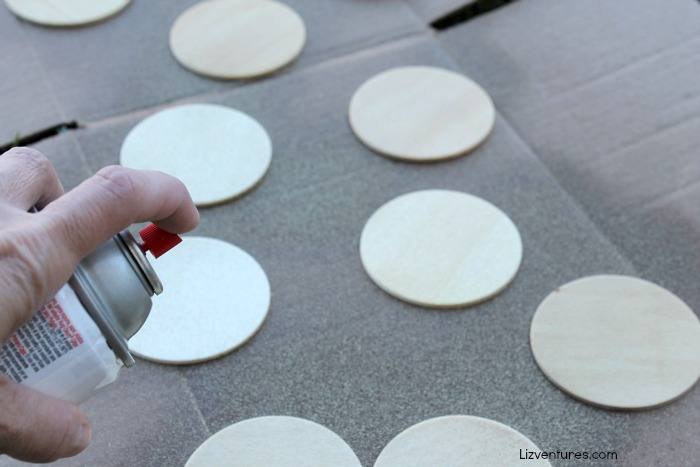 spray paint circular wooden discs