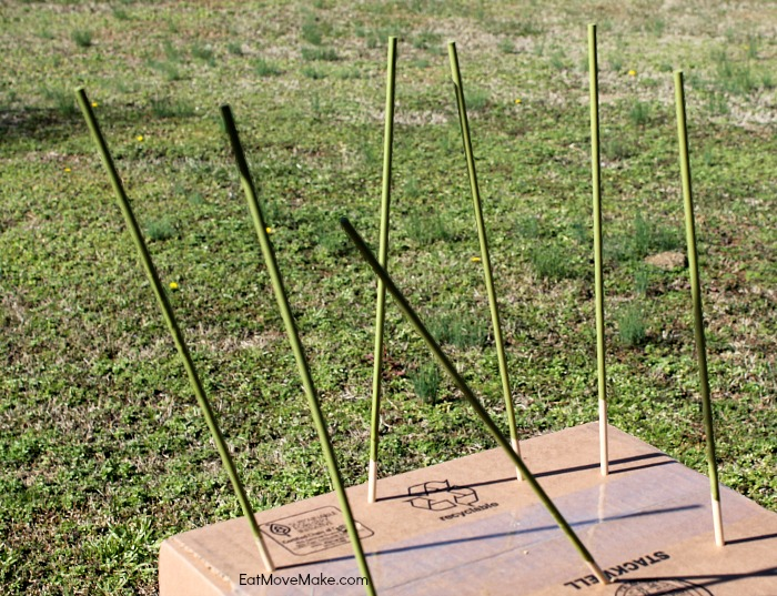 poke painted wooden dowels in box to dry