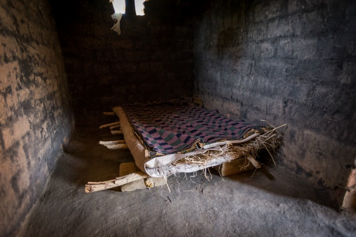 Eleven-year-old sponsored child Aden Muzyamba's bed made of hay and sticks at his home in Hamaundu, Zambia. He lives with his parents and is in Grade 4.