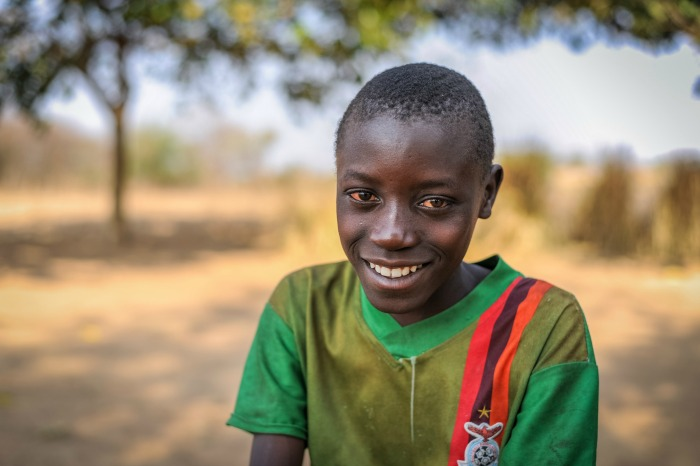Sponsored child Aden Muzyamba, 11, at his home in Hamaundu, Zambia. He lives with his parents and is in Grade 4.