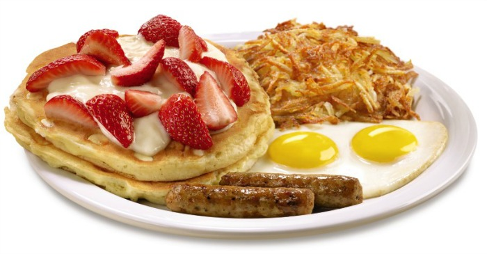Two buttermilk pancakes with juicy blueberries cooked inside and topped with fresh seasonal berries, bananas and whipped cream. Served with two eggs and hash browns, plus your choice of two strips of bacon or two sausage links.