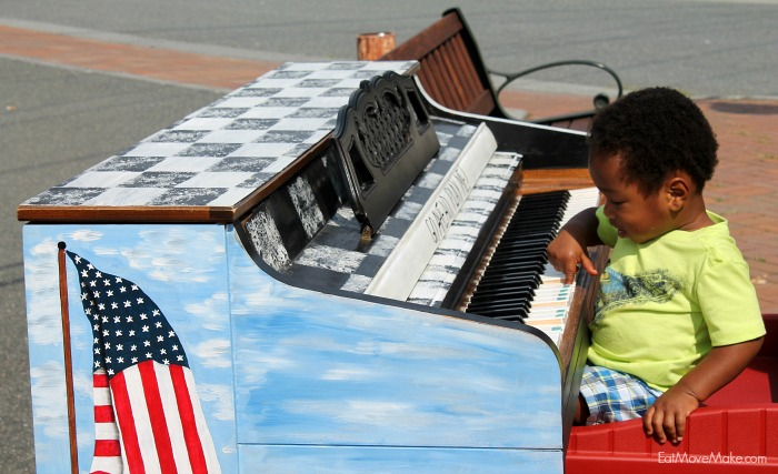little-boy-playing-piano-banner-elk-nc-public-art