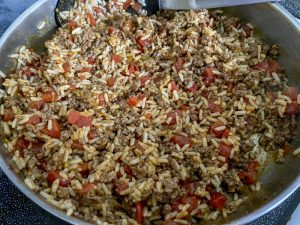 meat and rice mixture in skillet