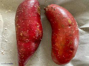raw sweet potatoes on baking sheet