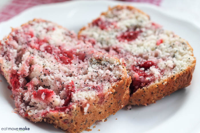 cherry almond poppyseed quick bread slices on plate
