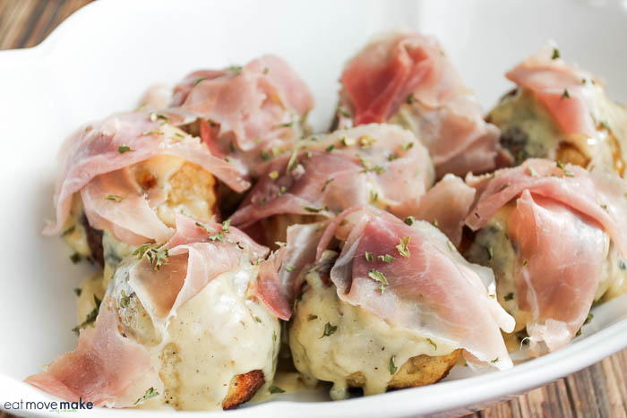 prosciutto and cheese on turkey meatballs in dish