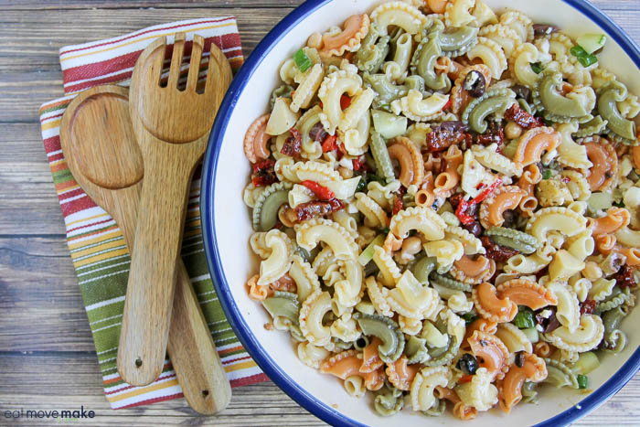 Artichoke and Sun Dried Tomato Pasta Salad in large bowl