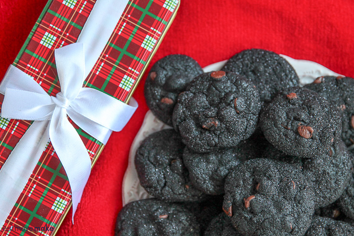 lump of coal cookies on plate next to present