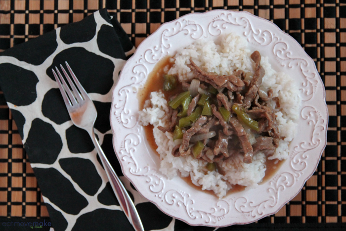 pepper steak skillet served on plate with rice