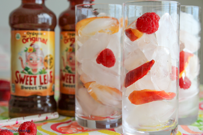 raspberries, peaches and ice in glasses