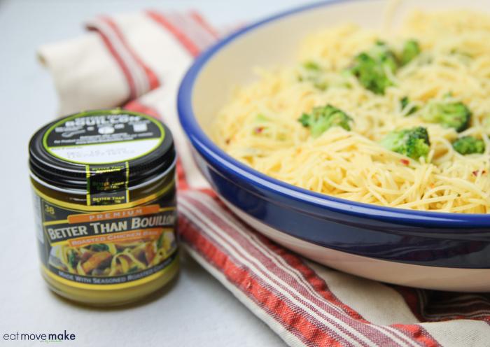 Better than Bouillon chicken base next to bowl of garlic pasta