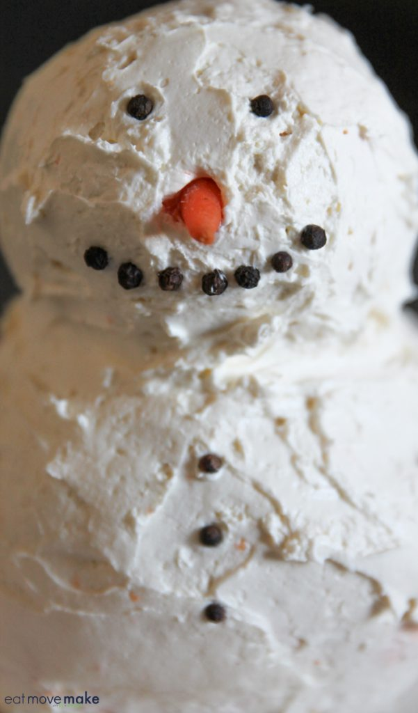 putting face on snowman cheese ball
