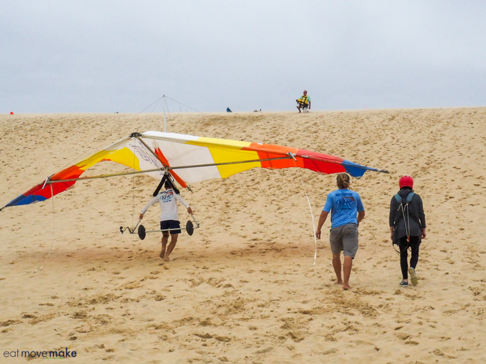 headed up the dune to hang glide