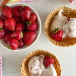 strawberry ice cream and strawberries on table